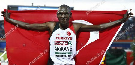 Stock Image of Polat Kemboi Arikan From Turkey Celebrates Winning the Men's 10000 M Race at the European Athletics Championships in the Olympic Stadium Amsterdam the Netherlands 08 July 2016 Netherlands Amsterdam