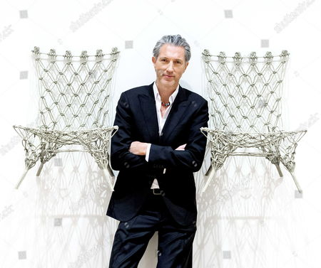 Dutch Designer Marcel Wanders Poses Between Tow of His Knotted Chairs During a Preview of His Exhibition Entitled 'Marcel Wanders: Pinned Up at the Stedelijk 25 Years of Design' at the Stedelijk Museum in Amsterdam the Netherlands 31 January 2014 the Retrospective Opens to the Public From 01 February to 15 June Netherlands Amsterdam