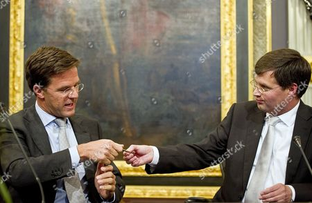 Outgoing Dutch Prime Minister Jan Peter Balkenende (r) Hands Over the Key of His Office to His Successor Mark Rutte (l) in the Hague Netherlands 14 October 2010 the Netherlands' First Minority Government Since World War Ii was Sworn in 127 Days After Dutch Voters Had Cast Their Ballots Mark Rutte of the Vvd is the Country's First Liberal Prime Minister to Take Power in 92 Years Netherlands the Hague