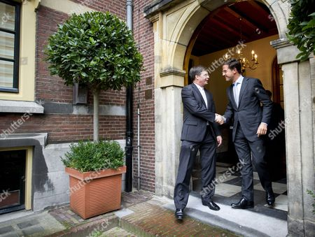 New Dutch Prime Minister Mark Rutte (r) Says Farewell to His Predecessor Jan Peter Balkenende (l) at the Doorstep of the Prime Ministers' Office in the Hague Netherlands 14 October 2010 the Netherlands' First Minority Government Since World War Ii was Sworn in 127 Days After Dutch Voters Had Cast Their Ballots Mark Rutte of the Vvd is the Country's First Liberal Prime Minister to Take Power in 92 Years Netherlands the Hague