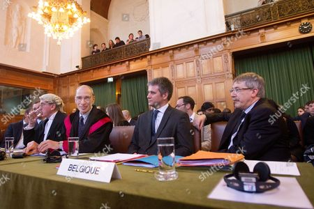 (l-r) Mr Paul Rietjens Mr Gerald Dive Mr Eric David and Mr Michael Wood Representing Belgium Await the Start of Proceedings at the International Court of Justice (icj) in the Hague on 12 March 2012 the Icj is Hearing a Request From Belgium to Extrdite Chad's Ex President Hissene Habre For Trial For Alleged Atrocities Habre 69 is Accused of Killing and Torturing Tens of Thousands of Opponents Between 1982 and 1990 - Charges He Denies Netherlands the Hague