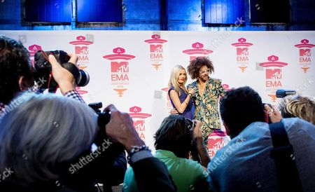 Hosts of Ceremony Irish Presenter For Mtv Europe Laura Whitmore (l) and Us Singer of Lmfao Stefan Kendal Gordy Aka Redfoo (r) Pose For Photographs During the Press Conference For the Mtv Europe Music Awards 2013 at the Ziggo Dome in Amsterdam the Netherlands 09 November 2013 the Award Ceremony Will Take Place on 10 November Netherlands Amsterdam