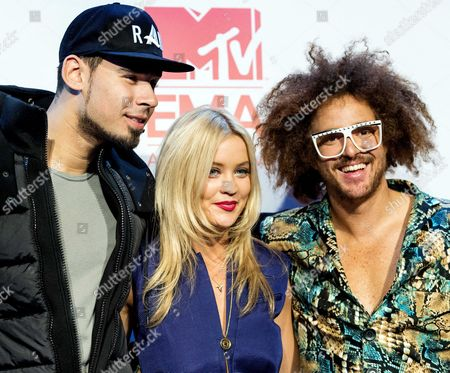 (l-r) Hosts of Ceremony Dutch Dj Afrojack Irish Presenter For Mtv Europe Laura Whitmore and Us Singer of Lmfao Stefan Kendal Gordy Aka Redfoo Pose For Photographs During the Press Conference For the Mtv Europe Music Awards 2013 at the Ziggo Dome in Amsterdam the Netherlands 09 November 2013 the Award Ceremony Will Take Place on 10 November Netherlands Amsterdam