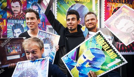(l-r) Dutch Djs Armin Van Buuren Hardwell Afrojack Dash Berlin and Tiesto (not Pictured) Are Handed Their Own Stamps During the Opening of the Amsterdam Dance Event in Amsterdam the Netherlands 15 October 2014 the Global Success of Dutch Dance Music Has Led Postal Company Postnl to Design the New Set of Stamps Netherlands Amsterdam
