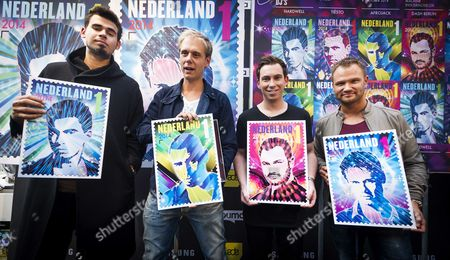 (l-r) Dutch Djs Afrojack Armin Van Buuren Hardwell Dash Berlin and Tiesto (not Pictured) Are Handed Their Own Stamps During the Opening of the Amsterdam Dance Event in Amsterdam the Netherlands 15 October 2014 the Global Success of Dutch Dance Music Has Led Postal Company Postnl to Design the New Set of Stamps Netherlands Amsterdam