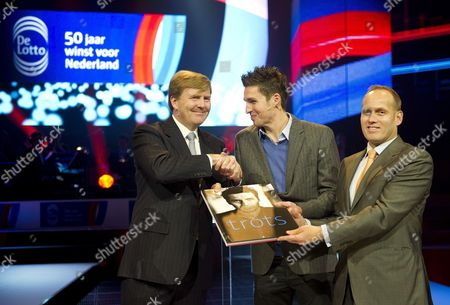 Dutch Prince Willem-alexander Receives the Book 'Proud' From Swimmer Pieter Van Den Hoogenband (c) and Ceo of Lotto Harrie Linders (r) in Occasion of the 50-years Anniversary of the Lotto (dutch Lotery) in the Hague the Netherlands 12 December 2011 Netherlands the Hague