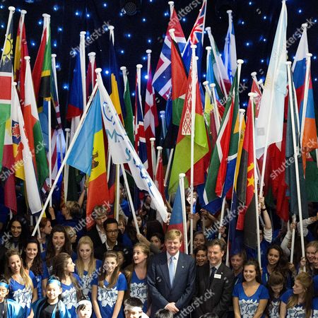 Stock Photo of Dutch King Willem-alexander (c) and Uwc Maastricht Head Peter Howe (c-r) Pose with Students During the Official Opening of the New Campus of the United World Colleges (uwc) in Maastricht the Netherlands 11 October 2013 Netherlands Maastricht