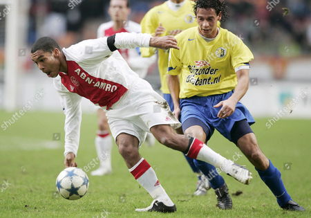 Stock Photo of Nigel De Jong (l) of Ajax Amsterdam Fights For the Ball with Virgilio Teixeira of Rkc Waalwijk During Their Dutch Premier League Soccer Match in Amsterdam Sunday 04 December 2005 Netherlands Amsterdam