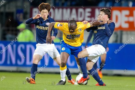 Rkc Waalwijk Player Evander Sno (c) Fights For the Ball Against Psv Eindhoven Players Ji-sung Park (l) and Santiago Arias During the Dutch Eredivisie Soccer Match Between Rkc Waalwijk and Psv Eindhoven in Waalwijk Netherlands 02 February 2014 Waalwijk Won 2-0 Netherlands Waalwijk
