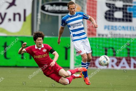 Pec Zwolle Player Bart Van Hintum (r) in Action with Psv Eindhoven Player Ji Sung Park (l) During the Dutch Eredivisie Soccer Match Between Pec Zwolle and Psv Eindhoven in Zwolle the Netherlands 27 April 2014 Netherlands Zwolle
