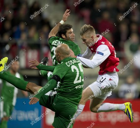 Stock Image of Maccabi Haifa Player Edin Cocalic (l) and Dekel Keinan (c) in Action with Az Alkmaar Player Aron Johannsson (r) During the Uefa Europa League Stage Soccer Match in Alkmaar the Netherlands 28 November 2013 Netherlands Alkmaar