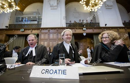 The Croatian Delegation Vesna Crnic-grotic (r) Philippe Sands and James Crawford (l) Sit in the Courtroom at the International Court of Justice (icc) During the First Day of the Witnesses in the Croatia Vs Serbia Case in the Peace Palace in the Hague the Netherlands 10 March 2014 Croatia Accuses Neighboring Country Serbia of Committing Genocide in the 1990s at the Breakup of Yugoslavia Netherlands the Hague