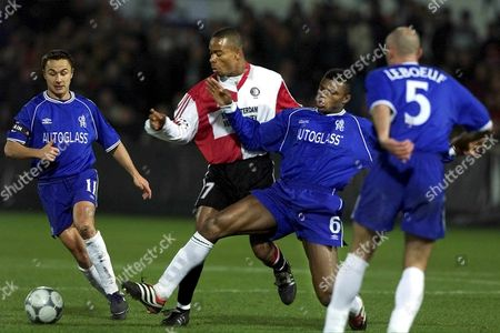 Rot04-20000313-rotterdam Netherlands: Feyenoord Rotterdam's Player Kalou (2nd L) Duels For the Ball with Chelsea's Player Desailly (2nd R) While Chelsea's Franck Leboeuf (r and Another Unidentified Player (l) Watch the Scene During Their Champions League Match in Rotterdam on Tuesday Evenig 14 March 2000 Rotterdam was Defeatd by Chelsea 1-3 Epa Photo Anp/team/kr Netherlands Rotterdam