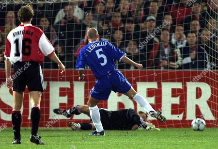 Rot03-20000314-rotterdam Netherlands: Feyenoord's Goalman Dudek (on Ground) Stops the Penalty Shot by Chelsea's Frech Player Franck Leboeuf (c) While Rotterdam's Player Konterman (l) Looks on During Their Champions League Match in Rotterdam on Tuesday Evening 14 March 2000 (electronic Image) Epa Photo Anp/oudenaarden/juinen/kr Netherlands Rotterdam