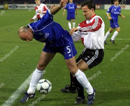 Rot02 - 20000314 - Rotterdam Netherlands : Feyenoord Rotterdam Player Jean-paul Van Gastel (r) Duels For the Ball with Chelsea Player Franck Leboeuf During Their Champions League Match in Rotterdam Tuesday 14 Marh 2000 (electronic Image) Epa Photo Anp/team Netherlands Rotterdam