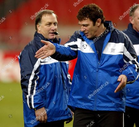 Nl01 - 20020211 - Amsterdam Netherlands : Assistent-coach and Former International Willem Van Hanegem (r) Gives Instructions to Coach of the Dutch National Soccer Team and Former Glasgow Rangers Coach Dick Advocaat During a Training Session at Ajax Arena Stadium in Amsterdam Monday 11 February 2002 the Team Will Play a Friendly Match on Wednesday 13 February Against England the First Under the New Leadership Epa Photo Anp/ed Oudenaarden/dhr/mr Netherlands Amsterdam