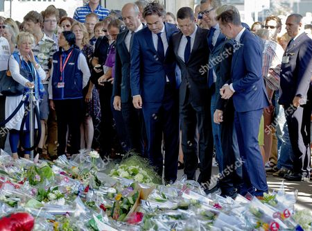 Dutch Airlines Klm President Camiel Eurlings (2-l) and Coo Klm Pieter Elbers (3-r) Lay Flowers After Taking Part in the One Minute's Silence at Schiphol Airport Near Amsterdam the Netherlands 23 July 2014 to Commemorate the Victims of the Air Crash of Malaysia Airlines Flight Mh17 in Easter Ukraine the Moment the First Bodies Have Arrived From Kharkiv on Eindhoven Airbase Netherlands Schiphol