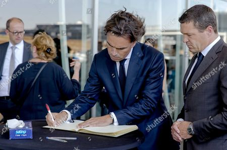 Dutch Airlines Klm President Camiel Eurlings (c) and Coo Klm Pieter Elbers (r) Sign the Condolence Register at Schiphol Airport Near Amsterdam the Netherlands 23 July 2014 After Taking Part in the One Minute's Silence to Commemorate the Victims of the Air Crash of Malaysia Airlines Flight Mh17 in Easter Ukraine the Moment the First Bodies Have Arrived From Kharkiv on Eindhoven Airbase Netherlands Schiphol