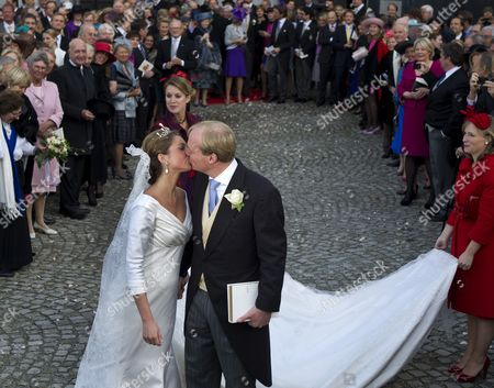 Dutch Journalist Annemarie Gualtherie Van Weezel Kisses Her Husband Prince Carlos De Bourbon De Parme After Thier Wedding Outside the Ter Kamen Abbey in Brussels Belgium 20 November 2010 the Church Wedding of Prince Carlos De Bourbon De Parme Son of Dutch Princess Irene and Late Prince Carlos Hugo Took Place in the Abbey Belgium Brussels