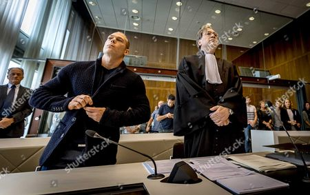 Stock Image of Dutch Gymnast Yuri Van Gelder 33 (left) Stands Alongside His Legal Representative at the Courthouse in Arnhem 12 August 2016 Gelder who was Sent Home From the Olympic Games in Rio For Going out and Drinking Beers Without Consent of the Team Management is Taking Legal Action Against the Dutch Olympic Committee He Plans to Continue Training in the Hope He Will Be Allowed to Return to Rio in Time to Compete in Next Week's Still Lrings Final Netherlands Arnhem