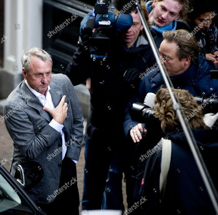 Stock Picture of Former Dutch Soccer Player and Fc Barcelona Coach Johan Cruyff (l) Arrives at the Court in Haarlem the Netherlands 07 December 2010 For the Lawsuit He Filed Against Soccer Club Ajax Nv and Its Board Members Steven Ten Have Edgar Davids Marjan Olfers and Paul Romer Cruyff is Challenging the Appointment of Interim Directors Martin Sturkenboom and Danny Blind and the Planned Appointment of Ceo Louis Van Gaal Netherlands Haarlem