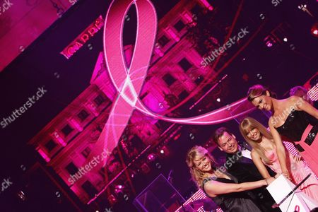 (l-r) Ceremony Host Chantal Janzen Managing Director of Estee Lauder Benelux Henk Van Der Mark Dutch Model Sylvie Van Der Vaart and Pink Ribbon Ambassador Quinty Trustfull Turn on Pink Floodlights on the Carre Theatre Building As They Attend the Pink Ribbon Gala in Amsterdam Netherlands 28 September 2009 This Event is Held to Call Attention to the Breast Cancer Fight Netherlands Amsterdam