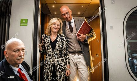Dutch Minister of Culture Jet Bussemaker (c) and Author Tommy Wieringa (r) Pose For Photos As They Board a Train Headed to Frankfurt For the Frankfurt Book Fair Amsterdam the Netherlands 18 October 2016 the Book Fair is the Largest in the World and Will Run From 19 - 23 October Netherlands Amsterdam