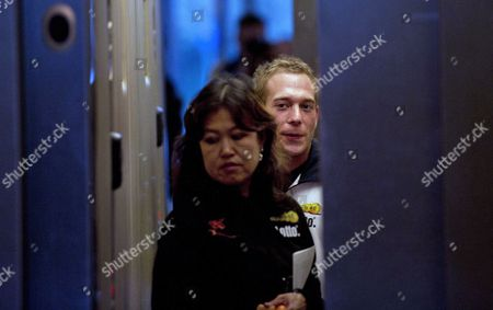 Dutch Gymnast Yuri Van Gelder (r) and His Sports Physician Liesbeth Lim (l) Are Pictured in an Elevator of a Hotel in Ridderkerk where the Dutch Gymnastic Team Stays 12 October 2010 Van Gelder Has Withdrawn From the World Championships Which Starts 16 October 2010 in Rotterdam Because of 'Considerable Reasons' Earlier This Year Van Gelder Started Again His Gymnastic Career After Being Disqualified For Years Because of Cocaine Use Netherlands Rotterdam