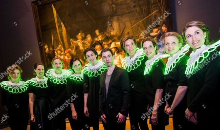 Dutch Dj Hardwell (c) Poses with Dutch Princess Marilene (4-r) and Staff of the Museum's Development Department in Front of the Painting 'Nachtwacht' by Rembrandt at the Rijksmuseum in Amsterdam the Netherlands 13 February 2014 Prior to His Performance For 'Friends' of the Museum Netherlands Amsterdam