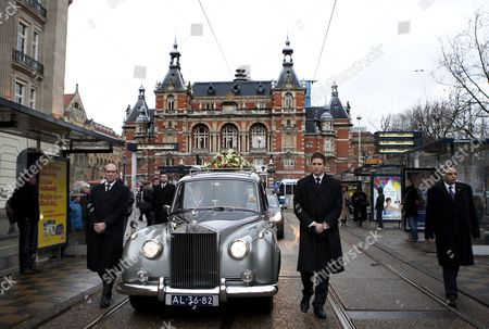 Stock Image of The Car with the Coffin of Late Singer of Disco Band Boney M Bobby Farrell Leaves After a Funeral Service at the Stadsschouwburg Theatre in Amsterdam the Netherlands 08 January 2011 Farrell Died of Heart Attack at the Age of 61 in a Hotel Room in St Petersburg on 30 December 2010 Netherlands Amsterdam