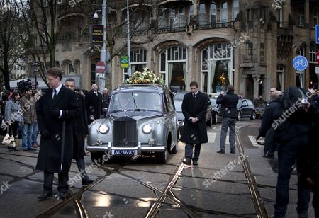 Stock Photo of The Car with the Coffin of Late Singer of Disco Band Boney M Bobby Farrell Leaves After a Funeral Service at the Stadsschouwburg Theatre to Zorgvlied Cemetery in Amsterdam the Netherlands 08 January 2011 Farrell Died of Heart Attack at the Age of 61 in a Hotel Room in St Petersburg on 30 December 2010 Netherlands Amsterdam