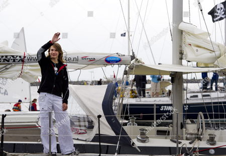 Dutch Fourteen Year-old Laura Dekker Waves to Hundreds of Well-wishers (unseen) Before Setting Sail From the Port in Den Osse Zeeland the Netherlands 04 August 2010 Dutch Teenager Laura Dekker Embarked on an Attempt to Become the Youngest Person to Sail Solo Around the World the Current Record As the Youngest to Sail Around the World Solo is Held by Jessica Watson of Australia who Completed Her Voyage 15 May 2010 Three Days Before Her 17th Birthday Dekker Turns 17 in September 2012 Netherlands Brouwershaven