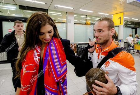 Dutch National Soccer Team Player Wesley Sneijder (r) is Greeted by His Wife Yolanthe Sneijder-cabau (l) As He Arrives at Schiphol Airport in Amsterdam Netherlands 27 May 2014 the Dutch Team Returned From a Training Camp in Lagos Portugal where They Prepared For the Fifa World Cup 2014 in Brazil Netherlands Schiphol