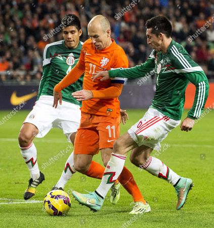 Dutch Player Arjen Robben (c) Vies For the Ball with Miguel Angel Herrera (l) and Hector Herrera of Mexico During the Friendly Soccer Match Between the Netherlands and Mexico in Amsterdam the Netherlands 12 November 2014 Netherlands Amsterdam