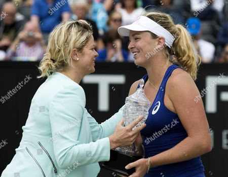Former World Number One Kim Clijsters (l) Awards the Us Coco Vandeweghe with the Trophy After Defeating Chinese Jie Zheng (l) During the Final of the Topshelf Open in Rosmalen the Netherlands on Saturday 21 June 2014 Vandeweghe Defeated Chinese Jie Zheng in 2 Sets 6-2 6-4 Netherlands Rosmalen