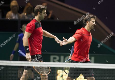 Spaniards Marcel Granollers (r) and Marc Lopez React During Their Men's Doubles Quarter-final Match Against Dutch Robin Haase and German Andre Begemann For the Abn Amro World Tennis Tournament in Rotterdam Netherlands 13 February 2015 Netherlands Rotterdam