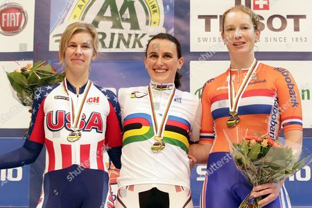 Canada's Tara Whitten (c) Smiles on the Podium After Winning the Women's Omnium Competition at the Uci Track Cycling World Championships in Apeldoorn Netherlands 27 March 2011 Whitten Won Ahead of Second Placed Sarah Hammer (l) of the Usa and Third Placed Dutch Kirsten Wild (r) Netherlands Apeldoorn