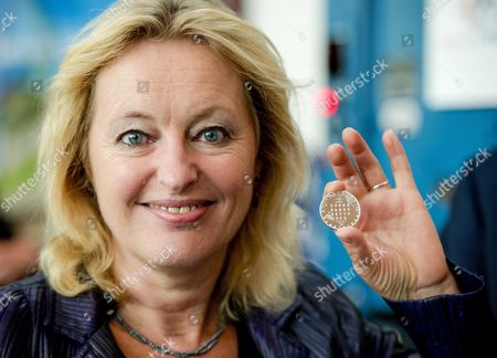 Dutch Minister of Education Jet Bussemaker Holds the First Molen Vijfje at the Dutch Munt in Utrecht the Netherlands 25 August 2014 the Coin Marks the Fact That the Mills of Kinderdijk Are on the World Heritage List of Unesco Netherlands Utrecht