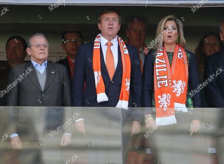(from Left) Australian Soccer Federation Chairman Frank Lowy Dutch King Willem-alexander and Queen Maxima Pictured Before Kick-off of the Fifa World Cup 2014 Group B Preliminary Round Match Between Australia and the Netherlands at the Estadio Beira-rio in Porto Alegre Brazil 18 June 2014 (restrictions Apply: Editorial Use Only not Used in Association with Any Commercial Entity - Images Must not Be Used in Any Form of Alert Service Or Push Service of Any Kind Including Via Mobile Alert Services Downloads to Mobile Devices Or Mms Messaging - Images Must Appear As Still Images and Must not Emulate Match Action Video Footage - No Alteration is Made to and No Text Or Image is Superimposed Over Any Published Image Which: (a) Intentionally Obscures Or Removes a Sponsor Identification Image; Or (b) Adds Or Overlays the Commercial Identification of Any Third Party Which is not Officially Associated with the Fifa World Cup) Brazil Porto Alegre