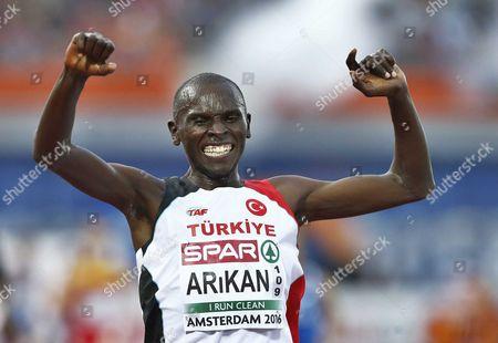 Stock Photo of Polat Kemboi Arikan From Turkey Celebrates Winning the Men's 10000 M Race at the European Athletics Championships in the Olympic Stadium Amsterdam the Netherlands 08 July 2016 Netherlands Amsterdam