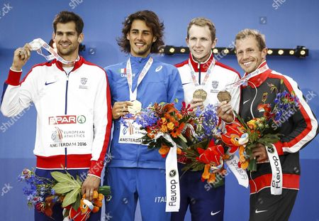 Gold Medal Winner Gianmarco Tamberi of Italy is Flanked by Silver Medalist Robbie Grabarz (l) From Great Britain and Bronze Medal Winners Chris Baker (2r) From Great Britain and Eike Onnen (r) From Germany During the Medal Ceremony of the Men's High Jump at the European Athletics Championships at the Olympic Stadium in Amsterdam Netherlands 10 July 2016 Netherlands Amsterdam