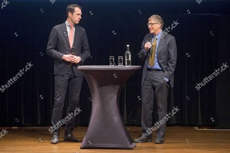 Us Philantropist and Microsoft Co-founder Bill Gates (r) and Dutch State Secretary For Economic Affairs Martijn Van Dam (l) at the Koninklijk Instituut Voor De Tropen in Amsterdam the Netherlands 26 February 2016 the Institute Supports Non-western Countries in Sustainable Development and Informs the Public About the Tropics and Sub-tropics Netherlands Amsterdam