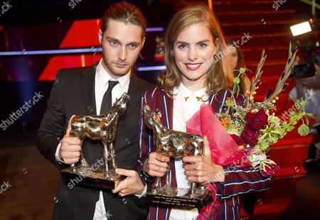 Winners Reinout Scholten Van Aschat (l Best Actor) and Hannah Hoekstra (best Actress) Pose with Their Awards During the Golden Calf Awards As Part of the Netherlands Film Festival in Utrecht the Netherlands 05 October 2012 Netherlands Utrecht