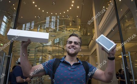 Dutch It Student Justin (no Last Name Available) Poses with His Purchase After Being the First Customer to Buy the New Iphone 7 in the Apple Store in Amsterdam the Netherlands 16 September 2016 at the Start of Iphone 7 Sales Apple's Share Price Jumped More Than Three Per Cent Following Reports It Had Already Sold out Certain Iphone 7 Models with Specific Colours Especially in 'Jet Black' Colour and the Plus Models Apple Also Said Online Orders May Take Longer to Due to Brisk Sales of Its Latest Flasghip Smartphone Netherlands Amsterdam