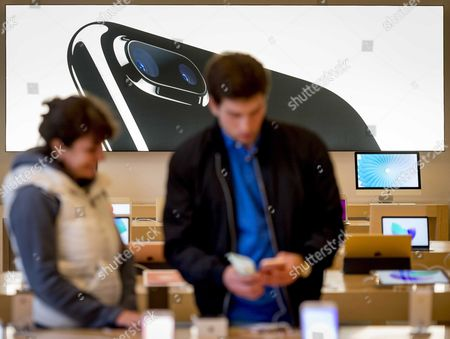Customers Seen Inside the Apple Store in Amsterdam the Netherlands 16 September 2016 at the Start of Iphone 7 Sales Apple's Share Price Jumped More Than Three Per Cent Following Reports It Had Already Sold out Certain Iphone 7 Models with Specific Colours Especially in 'Jet Black' Colour and the Plus Models Apple Also Said Online Orders May Take Longer to Due to Brisk Sales of Its Latest Flasghip Smartphone Netherlands Amsterdam