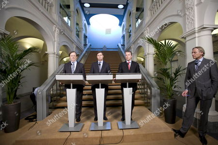 Dutch Central Bank Chief Nout Wellink (l) Prime Minister Jan Peter Balkenende and Minister of Finance Wouter Bos Address the Media During a Press Conference in the Hague Netherlands 03 October 2008 the Netherlands Government Confirmed It was Nationalising the Dutch Activities of Embattled Belgian-dutch Banking Group Fortis at a Cost of 16 8 Billion Euros a Move It Hoped Would Reassure Investors Netherlands the Hague
