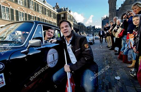 Dutch Caretaker Prime Minister Mark Rutte (r) Poses with Former Prime Minister Jan-peter Balkenende (l) Sitting in a Participating Car Before Starting of the So-called Zzf Rally Which Tries to Collect Money For a Fund of Rare Diseases in the Hague the Netherlands 07 October 2012 Netherlands the Hague