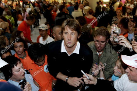 Stock Photo of Dutch Goalkeeper Edwin Van De Sar is Asked For Photographs As the Dutch Arrives at Amsterdam's Schiphol Airport Late Monday 26 June 2006 Netherlands Amsterdam