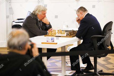 Russian Chess Grandmasters Anatoly Karpov (r) and Dutch Chess Grandmaster Jan Timman (l) Play a Game Against Each Other in the Groninger Museum in Groningen the Netherlands 26 December 2013 During the Groningen Chess Festival Karpov and Timman Play the Match in the Framework of Netherlands-russia Year a Year in Which the Netherlands and Russia Emphasize Their Longábilateral Relations Netherlands Groningen