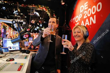 Dutch Minister of Education Culture and Science Jet Bussemaker (r) and Radio Dj Bart Arens (c) of the Dutch National Radio Station Radio 2 Raise a Glass As They Kick Off the Annual 'Top 2000' Countdown in Hilversum the Netherlands 25 December 2015 This Marathon Radio Program Plays the 2 000 Most Popular Songs of All Time From Christmas Through to New Year's Eve Netherlands Hilversum